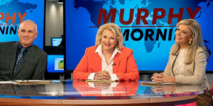 murphy-in-the-morning_frank-murphy-corky_sitting-at-on-air-desk_900x450